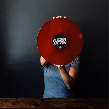 holding red vinyl